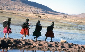 Girls spinning as they walk along Lake Titicaca.